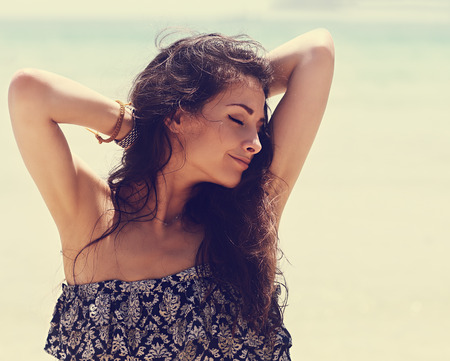 Photo for Happy beautiful closed eyes woman relaxing with epilation armpits on blue sea background. Closeup  vintage portrait - Royalty Free Image