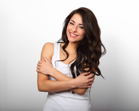 Photo pour Happy smiling beautiful woman hugging herself with natural emotional enjoying face on white background. Love concept  - image libre de droit
