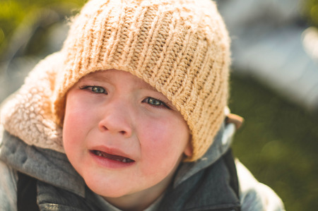 Photo pour Crying little boy. Cry. Portrait of boy. Caucasian child looks at camera. Charming boy the kid cries with tears in his eyes. - image libre de droit