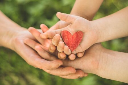 Photo pour Childs hand and old hand grandmother hold heart. Concept idea of love family protecting children and elderly people grandmother friendship togetherness relationship Two generation. - image libre de droit