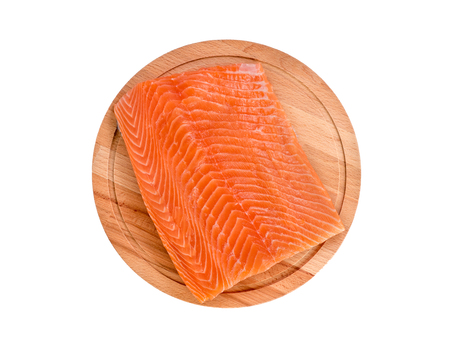 Foto de Fresh salmon fillet on wooden cutting board on white background, top view - Imagen libre de derechos