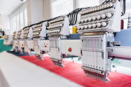 Foto de Industrial embroidery machine in textile production workshop - Imagen libre de derechos