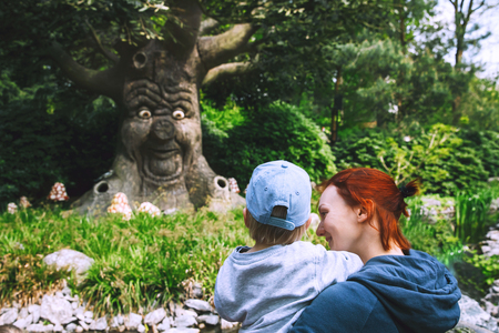 Foto de Family is having fun at amusement park. Fantasy themed amusement park Efteling in Kaatsheuvel, Holland, Netherlands, Europe. Attractions are based on elements from ancient myths, legends, fairy tales. - Imagen libre de derechos