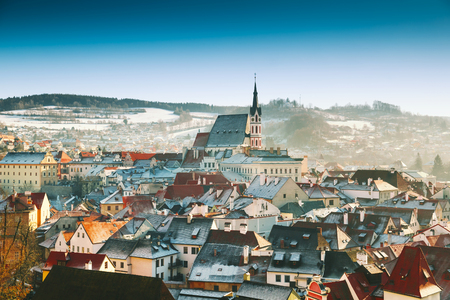 Photo for Panoramic view of Cesky Krumlov in winter, Czech Republic. View of the snow-covered red roofs. Travel and Holiday in Europe. Christmas and New Year time. Sunny winter day in european town. - Royalty Free Image