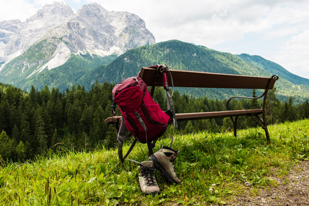 Photo for Hanging backpack and hiking shoes - Royalty Free Image