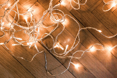 Photo for Christmas background with festive decoration,  sparkling  lights garland on a old antique wooden parquet floor - Royalty Free Image