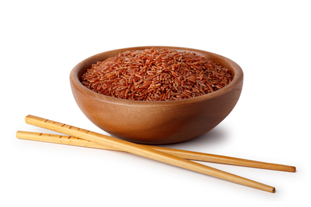 Photo pour A wooden bowl with red rice and food chopsticks. Natural products, healthy food. - image libre de droit