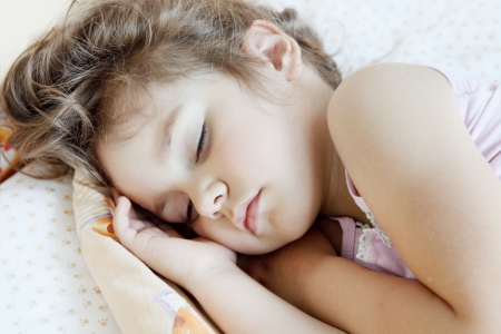 Little Child Girl Asleep in Her Bed Portrait