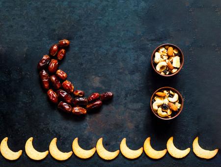 Photo pour Ramadan kareem. Dates fruit arranged in shape of crescent moon on vintage rusty metal background. Closeup, copy space. - image libre de droit