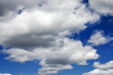 Photo for White fluffy clouds in a dark blue sky. Heavenly background - Royalty Free Image