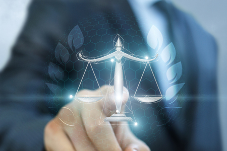 Photo for Lawyer clicks on the scales of justice on blurred background. - Royalty Free Image