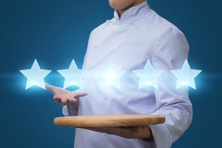 Photo pour Cook show five star rating. Restaurant rating concept - image libre de droit