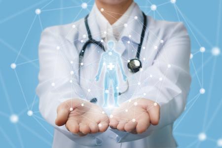 Foto für Doctor shows a hologram of a person on a blue background. - Lizenzfreies Bild