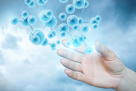 Foto de Structure of the molecule in hand on light blue background. - Imagen libre de derechos