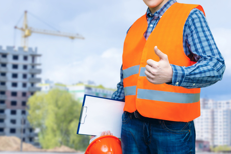 Photo for Builder shows quality construction on blurred background . - Royalty Free Image