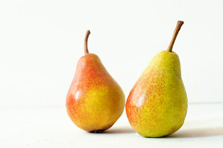 Photo for Two ripe red yellow pear fruits on white background - Royalty Free Image