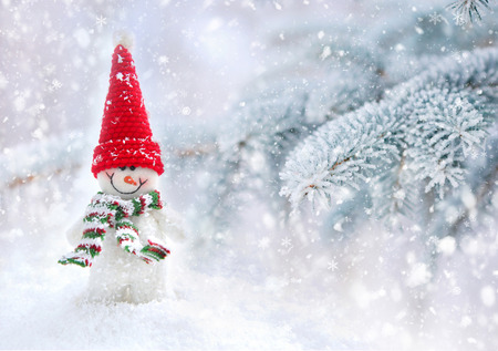 Foto de Snowman on a background snow-covered fir branches - Imagen libre de derechos
