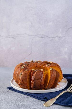 Foto de Pumpkin cupcake with honey on a gray background. - Imagen libre de derechos