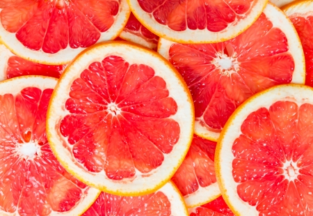 Photo for Texture of a ripe grapefruit slice, closeup - Royalty Free Image