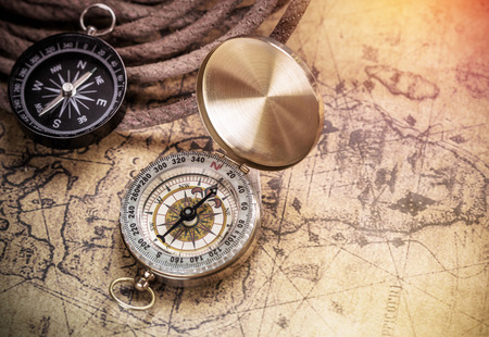 Photo for compass on vintage map with accessory to the Adventure. - Royalty Free Image
