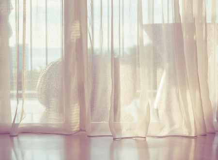 Foto de Door curtain with sunlight in the morning. - Imagen libre de derechos