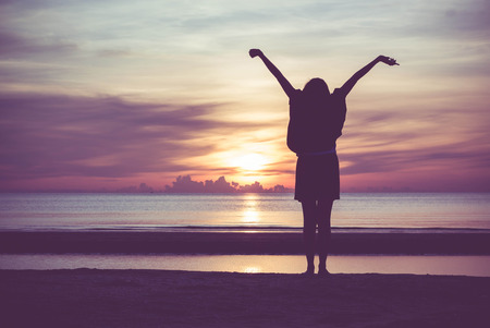 Photo for Woman spreading hands with joy and inspiration at sunrise. - Royalty Free Image