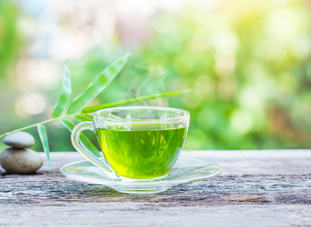 Photo for cups of green tea on wooden table - Royalty Free Image