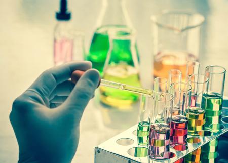 Foto de Scientist hand holding a Test tubes,Laboratory research. - Imagen libre de derechos