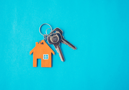 Foto per House and key on blue background. Minimal creative style. - Immagine Royalty Free