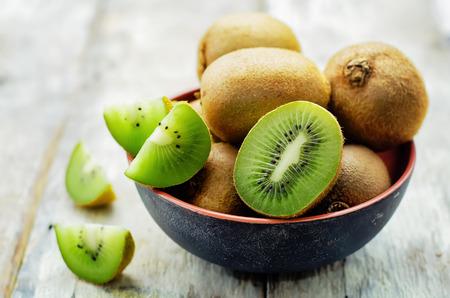 Photo for kiwi on white wood background. tinting. selective focus - Royalty Free Image
