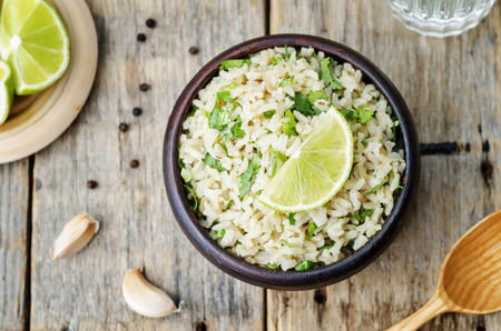 Foto de cilantro lime garlic brown rice. the toning. selective focus - Imagen libre de derechos