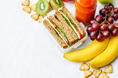 Photo for school lunch with a sandwich, fresh fruits, crackers and juice - Royalty Free Image