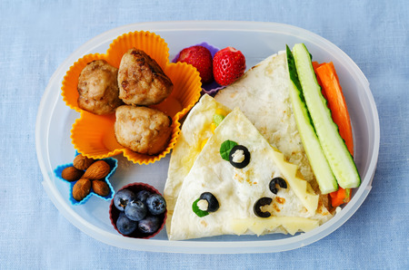 Photo for school lunch box for kids with food in the form of funny faces - Royalty Free Image