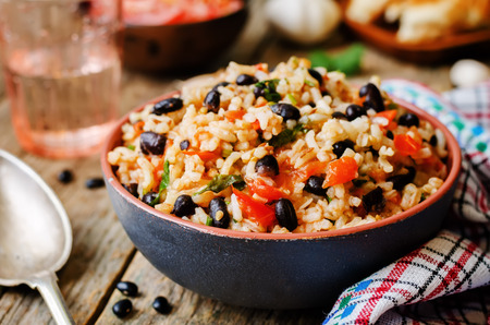 Foto de Mexican tomato black beans rice with cilantro. the toning. selective focus - Imagen libre de derechos