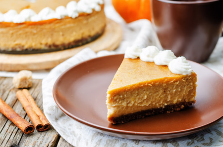 Photo for pumpkin cheesecake decorated with whipped cream. the toning. selective focus - Royalty Free Image