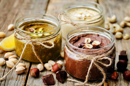 Photo for list toasted nut butters, pistachio, hazelnut and cashew - Royalty Free Image