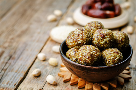 Photo for raw vegan dates sesame pistachio balls. toning. selective focus - Royalty Free Image