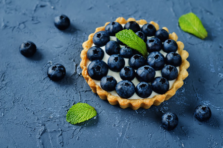 Photo for Blueberry tartlets. toning. selective focus - Royalty Free Image