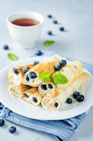 Photo for Sauteed Cream cheese Blueberry Crepes on a stone background. toning. selective focus - Royalty Free Image