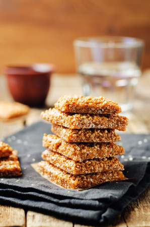 Photo for Honey sesame seed bars on a wood background. toning. selective focus  - Royalty Free Image