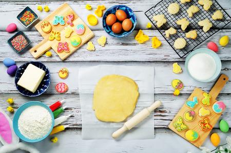 Foto de Sugar dough Easter cookies and ingredients for baking. toning. selective focus - Imagen libre de derechos