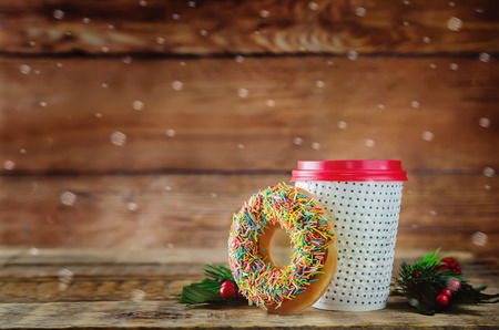 Photo for Donut with coffee on a wood background. toning. selective focus - Royalty Free Image
