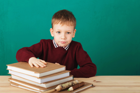 Photo for Young boy looking angry shaking his fists tired of school lessons, education. Tiredness stressing overworking children expressive emotional furious mad learning. Back to School. Emotional stress kids - Royalty Free Image