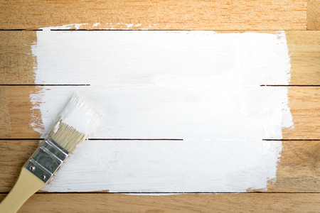 Photo for White paint space with paintbrush on wood background - Royalty Free Image