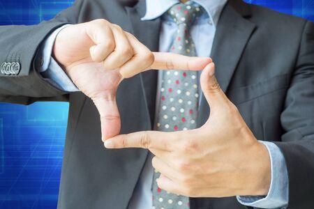 Foto de Finger frame action of businessman with clipping path for vision, focus or target concept. - Imagen libre de derechos