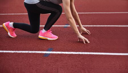 Photo for Female athletes  doing start runing in track  sport stadium with copy space - Royalty Free Image
