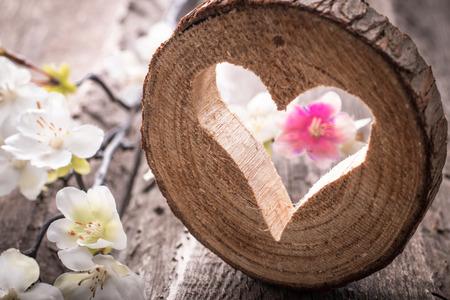 Foto de Light  heart on rustic wooden background - Imagen libre de derechos