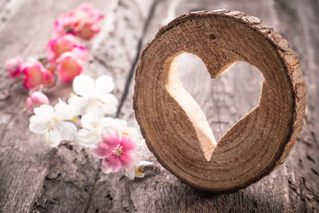 Photo for Light  heart on rustic wooden background - Royalty Free Image