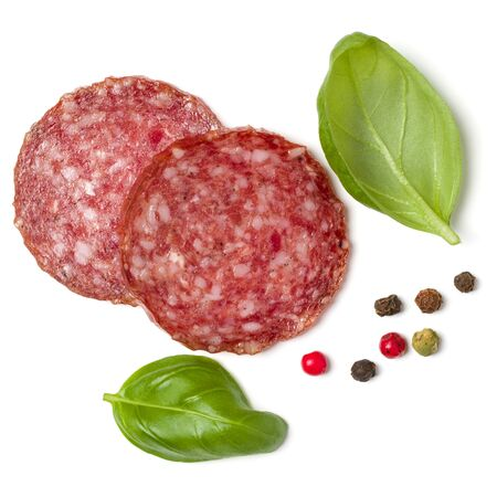Photo for Slices of salami isolated on white background closeup. Sausage and basil leaves top view. - Royalty Free Image