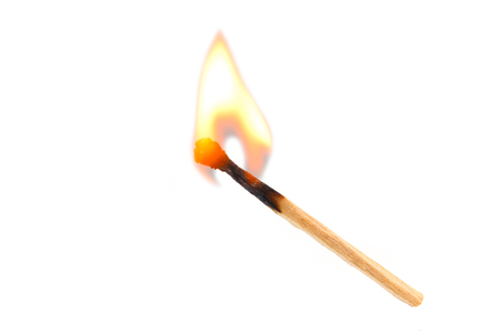 Foto de Burning safety-match with red, orange, yellow fire. Isolated on white background - Imagen libre de derechos